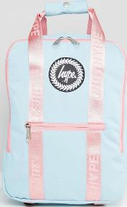 tote backpack in blue with pink straps
