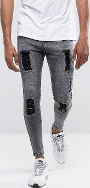 muscle fit jeans in acid wash black with distressing