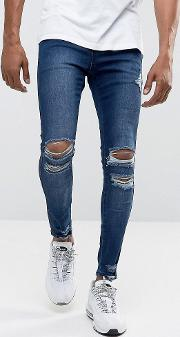 super skinny jeans  mid wash blue with distressing