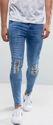 super skinny jeans  mid wash blue with knee rips