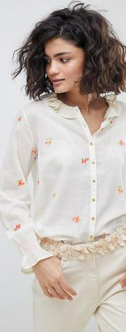 buttondown blouse with embroidered bouquets