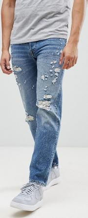 intelligence tapered fit jeans with distress detail