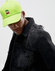 baseball cap in green with cherry embroidery