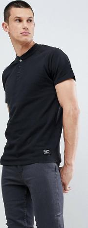 t shirt in black with popper detail