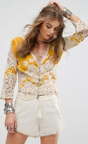 festival wrap front top with embroidery and crochet inserts