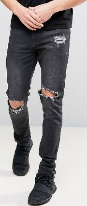washed black skinny jeans with knee rips