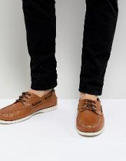 leather boat shoes in brown