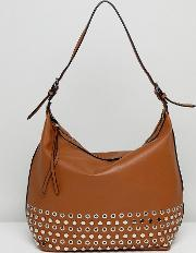slouchy shoulder bag with eyelet detailing