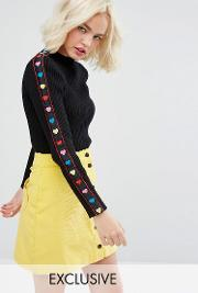 high neck jumper with rainbow hearts