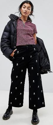 wide leg jeans with all over skull embroidery