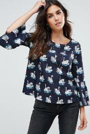 bell sleeved top with swan print
