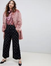 wide leg trousers in spot print