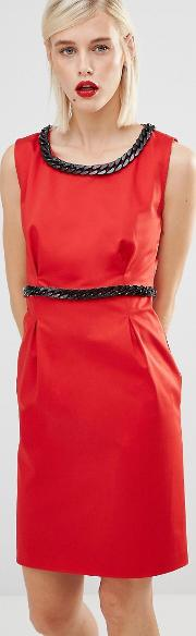 red dress with black chain embellishment