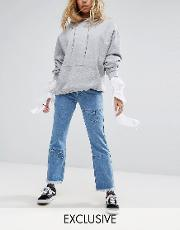 kick flare jeans with metal details