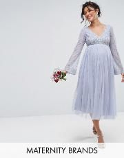 long sleeve midi dress with embellished sleeves and tule skirt