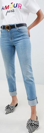 slim leg jeans with turn up hem in mid wash