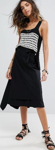 a line wrap skirt with button detail