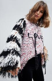 oversized flecked jumper with fringed sleeves and love slogan