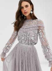 Embroidered Blouse With Button Detail And Sheer Sleeves
