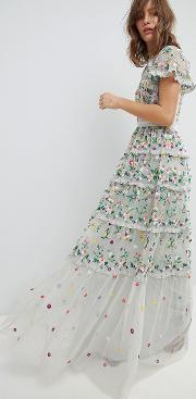 embroidered floral gown with high neck and tiered skirt