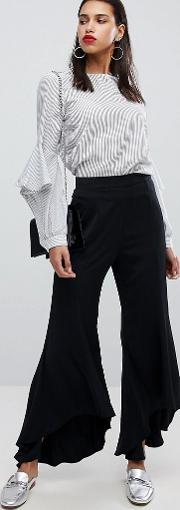 trouser with asymmetric flare hems