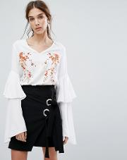 V Neck Top With Layered Ruffle Sleeves And Floral Embroidery