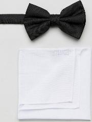 black bow tie and pocket square in white