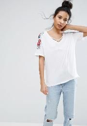 embroidered sleeve t shirt
