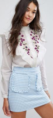 floral embroidered ruffle blouse