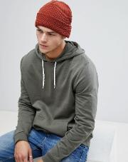knitted beanie in rust