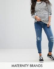 over bump distressed knee jeans