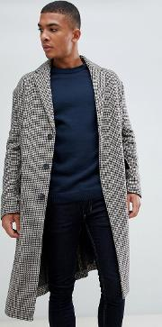 over coat in brown check