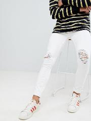skinny jeans with knee rips  white