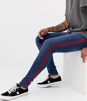 skinny jeans with red side stripe  blue wash