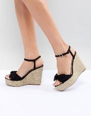 suedette bow wedge