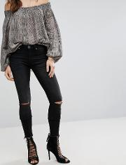 hoodlums skinny mid rise jean with rip knee and raw hem