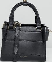 real leather hand held mini bag with detachable cross body strap