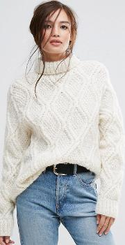 hand knitted cable  unbleached wool high neck oversized jumper