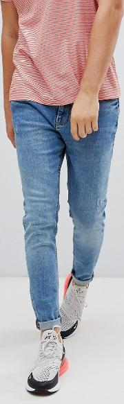 carrot fit jeans in mid blue