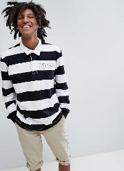 exclusive long sleeved striped polo top in black and white with logo