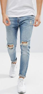 ripped jeans in carrot fit  mid wash blue