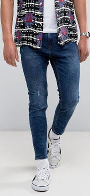 skinny carrot fit jeans  mid blue wash
