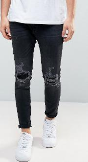 skinny carrot fit jeans with rip and repair detail  black