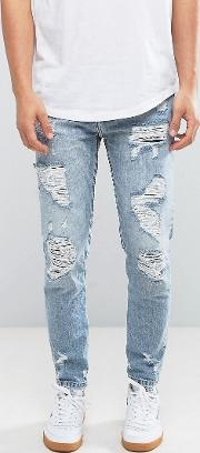 slim ripped jeans in mid wash