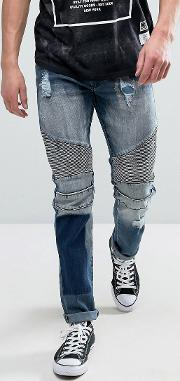 biker jeans in mid wash with distressing and patch