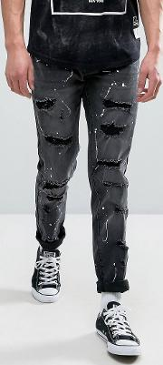 distressed jeans in washed black with bleach splat
