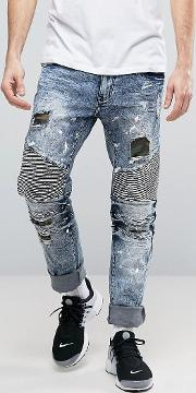 distressed slim jeans with camo patches