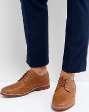 brogues in milled tan leather