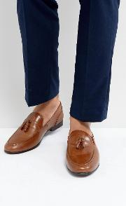 tassel loafers in tan leather