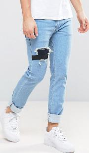 jeans in slim stretch fit with rips and elastic patch